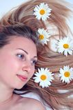 Beautiful woman with chamomile Stock Photos
