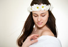 Beautiful woman in chamomile wreath Stock Image