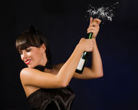 Beautiful woman with a champagne bottle Royalty Free Stock Photos