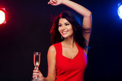 Beautiful woman with champagne glass at nightclub Stock Photography