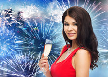 Beautiful woman with champagne glass over firework Royalty Free Stock Images