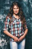 Beautiful woman in check shirt. In studio Royalty Free Stock Image