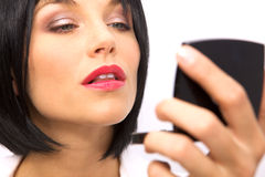 Beautiful Woman Checking her Makeup Royalty Free Stock Photography