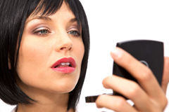 Beautiful Woman Checking her Makeup Royalty Free Stock Image