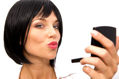Beautiful Woman Checking her Makeup Stock Image
