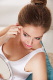 Beautiful woman checking her skin Royalty Free Stock Photography
