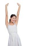 Beautiful woman cheering and looking at camera Royalty Free Stock Image