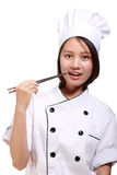Beautiful woman chef with chopsticks Stock Photography