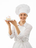 Beautiful woman chef cook showing cake Stock Photo