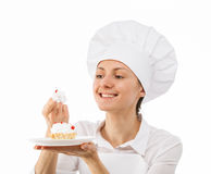 Beautiful woman chef cook tasting cake Stock Photo