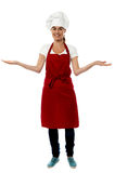 Beautiful woman chef welcoming Royalty Free Stock Photography