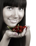 Beautiful woman with  cherries. Close-up photo of a beautiful woman with  cherries Royalty Free Stock Photo