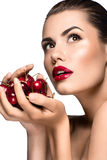Beautiful woman with cherry. Beautiful woman portrait with nice make up, red lipstick and cherry in her hand Stock Image