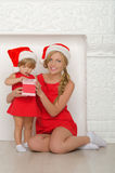 Beautiful woman with child in Santa costumes Stock Image