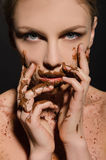 Beautiful woman with chocolate on her face Royalty Free Stock Image
