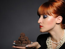 Beautiful woman with chocolate truffle sweets Royalty Free Stock Photos