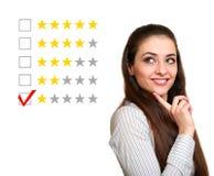 Beautiful woman choose one stars Stock Photography