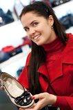 Beautiful woman choose shoes Stock Images