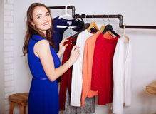 Beautiful woman chooses clothes in the wardrobe closet Royalty Free Stock Image