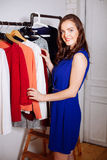 Beautiful woman chooses clothes in the wardrobe closet Royalty Free Stock Photo