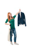 Beautiful woman chooses clothes Royalty Free Stock Images