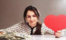 Beautiful woman choosing between career and family, between mone Stock Photos