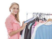Beautiful woman choosing clothes at clothing store Royalty Free Stock Photo