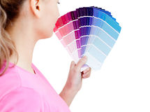 Beautiful woman choosing colors in her living-room Royalty Free Stock Image