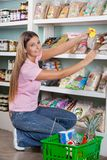 Beautiful Woman Choosing Food From Shelf Stock Images