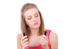 Beautiful woman choosing the lipstick Royalty Free Stock Photos