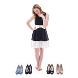 Beautiful woman choosing shoes isolated on white Stock Photo