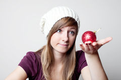 Beautiful woman with christmas bauble. Women choosing bauble for christmas. Choosing christmas decoration Stock Photo