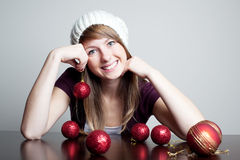 Beautiful woman with christmas bauble. Beautiful woman holding christmas bauble and smiling. Choosing christmas decoration Stock Image