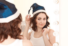 Beautiful woman in christmas cap Royalty Free Stock Images