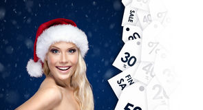 Beautiful woman in Christmas cap with good offer for discount Royalty Free Stock Image