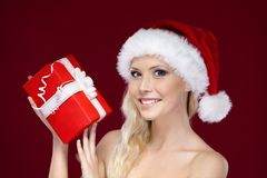 Beautiful woman in Christmas cap hands present Royalty Free Stock Photos