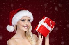 Beautiful woman in Christmas cap hands present Stock Photos