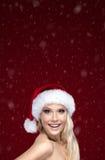 Beautiful woman in Christmas cap Stock Photo