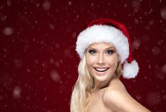 Beautiful woman in Christmas cap royalty free stock photos