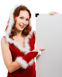 Beautiful woman in Christmas clothing Royalty Free Stock Images
