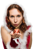 Beautiful woman in a Christmas dress sends a kiss Royalty Free Stock Photography