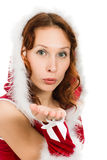 Beautiful woman in a Christmas dress sends a kiss Royalty Free Stock Images