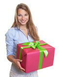 Beautiful woman with christmas gift in her hands Stock Photo