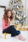 Beautiful woman with Christmas gift Royalty Free Stock Photo