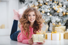 Beautiful woman with Christmas gift Royalty Free Stock Photography