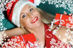 Beautiful Woman with Christmas Gifts and Snowflake stock photo