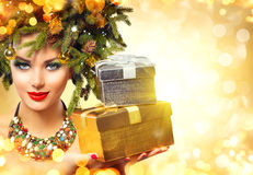 Beautiful woman with Christmas gifts Stock Photo