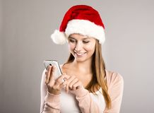 Beautiful woman with christmas hat Royalty Free Stock Photos