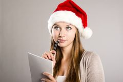 Beautiful woman with christmas hat Stock Photography