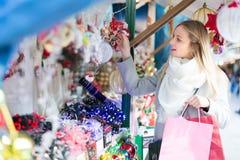 Beautiful woman at Christmas market Stock Photos
